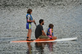 Girls paddling with Uncle Dan.